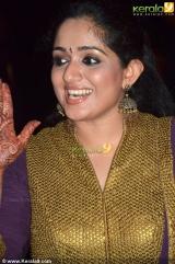 kavya madhavan at ann augustine wedding reception photos 007
