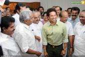 oommen chandi in sachin tendulkar at kerala blasters team announced photos