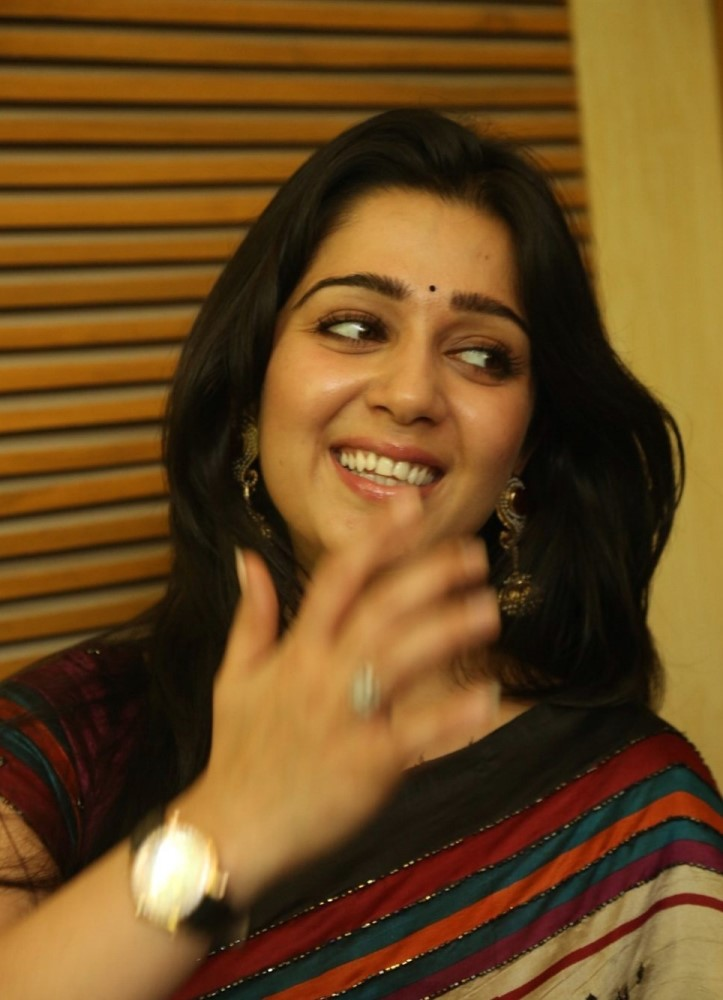 Actress Charmi Stills in Multi Color Printed Saree