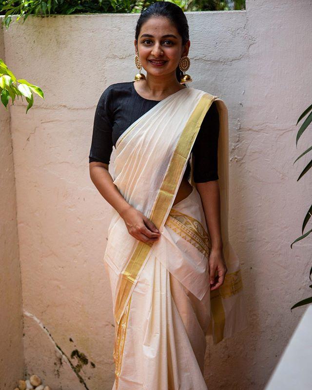 esther anil latest onam saree photos
