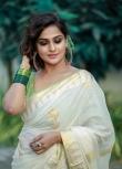 remya nambeesan new onam saree photos