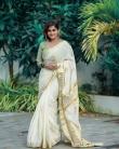 remya nambeesan new onam saree photos -002