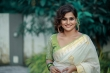 remya nambeesan new onam saree photos -003