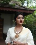 rima-kallingal-latest-photoshoot-in-onam-dress-001