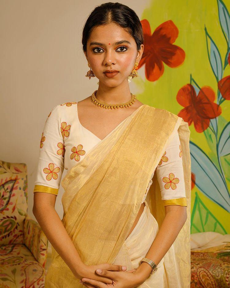 poornima indrajith daughter Prarthana onam saree photos